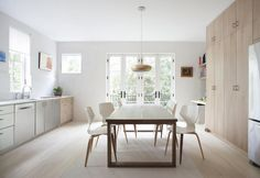 The clients wanted to make sure they ended up with no unused space: They did away with a rarely used formal dining room, and placed the dinner table (Mörbylånga from Ikea) in the center of the kitchen instead.French doors at the end of the kitchen open onto a new balcony that leads to a stair to the backyard.