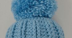 Big Pom Pom Ribbed Baby Hat a FREE Crochet Pattern for an adorable Baby Hat Fits newborn.