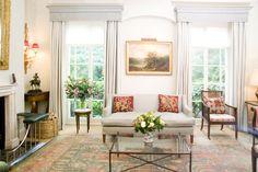 US Interior Designs: PHILIPPA DEVAS IN LONDON | fabulous non-stodgy traditional living room | pale walls and drapes | antique oriental rug | sleek sofa