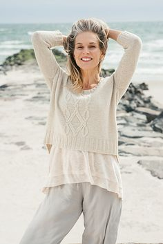 """Bennett Creek is worked in pieces from the bottom up and then seamed. The back and sleeves are worked in reverse stockinette stitch, and the front is worked in reverse stockinette stitch with a large cable pattern up the center front. The front is designed to be 2"""" shorter than the back."""