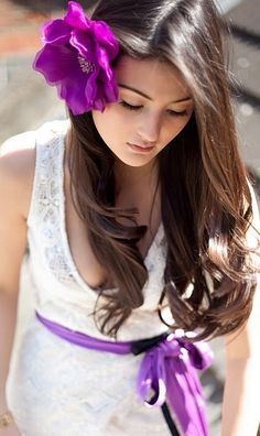 Love the combination of purple accents and a white lace dress.