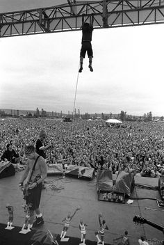 Eddie Veder after climbing the stage's scaffolding and before he swings from his microphone cord during a free show of Pearl Jam on september 20, 1992, in Seattle.