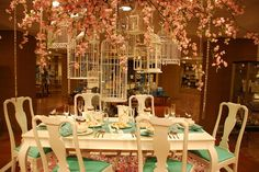 Birdcages and cherry blossom tablescape.