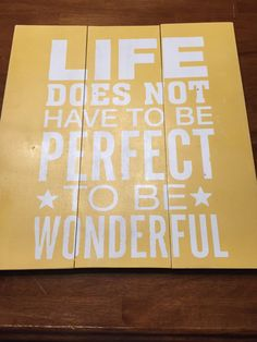 """Hand-painted wooden sign. Reads """"Life does not have to be perfect to be wonderful""""."""