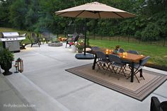 The reveal of our outdoor concrete patio with dining area and round fire pit with seating Poured Concrete Patio, Concrete Patio Designs, Concrete Backyard, Cement Patio, Concrete Patios, Small Backyard Patio, Backyard Patio Designs, Patio Ideas, Firepit Ideas