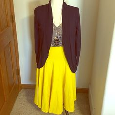 "Yellow full midi skirt This is beautiful soft yellow skirt. Has a flare to it and comes below the knees on me (and I am 5'6"") Only worn once. I love skirts but always tend to wear my jeans ha :) *only skirt for sale in this listing* no tags but fits a 14/16 Skirts Midi"