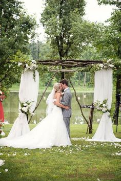 To me, this looks simple... go out to the woods, grab some branches, and put it together..the putting together part is for a man. add some wildflowers. mm nice #wedding #mybigday