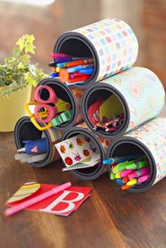 Recycle tin cans into storage by covering with scrapbook paper and gluing together.