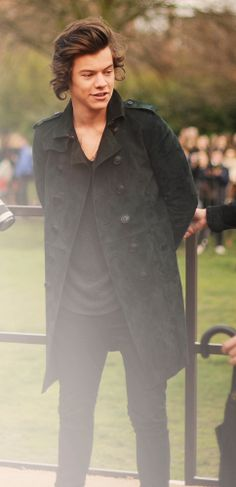 British musician Harry Styles in front of photographers at the Burberry A/W14 show in London