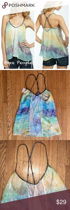 """NWT Free People Colorful Sequined Cami $88 NWT $88 women's size Large. Soft and flowing. Lace Inset on Front and Sides. Sequined Adjustable Straps. Semi Sheer. Bust 20"""" one way. Length 27"""" measurements are approx. 100% Polyester. Beautiful yellow, blue and purple tones. Free People Tops Tank Tops"""