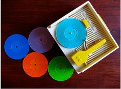 The Fisher Price record player with the multi-colored plastic records!!!