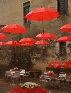 Umbrellas by Don_Gato (LoFi Photography), via Flickr. I once planned on decorating my apartment this way! I was going to do the walls in a blue-gray and then hang red umbrellas all over the ceiling. So when I saw this I loved it immediately. Unfortunately, I dont know where it is.