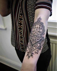 Half sleeve lower arm floral tattoo