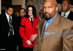Michael Jackson (3rd-L) and brother Jackie Jackson (L) and father Joe Jackson (2nd-L) depart the Santa Maria Superior Court during the third week of his trial March 14, 2005 in Santa Maria, California. Jackson is charged in a 10-count indictment with molesting a boy, plying him with liquor and conspiring to commit child abduction, false imprisonment and extortion. He has pleaded innocent.