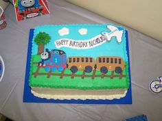 Thomas Train Cake I made this cake for a friend's son's 2nd birthday. He is a huge Thomas the Tank Engine fan. The train cars,...