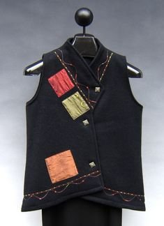 Amazing vest by Marie Jeffries. Wool base fabric embellished with silk and fancy yarn. Awesome design execution. See her work at Five Crows in Natick, MA.