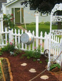 garden by patrica  There is just something about a fence! Would love to have a fenced in garden!