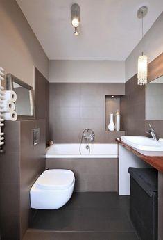 Carrelage salle de bains anthracite et baignoire lot oeuf for Baignoire ilot oeuf