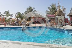 Swimming pool in Hotel resort on the coast of the Atlantic Ocean in Gambia. Africa . The men play in water polo