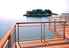 The combination of stainless steel wire mesh and cedar makes this railing infill panel an elegant design.