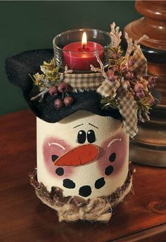 Snowman Candle Jar ~ Winter usually brings snow. and soon snowmen will pop up everywhere throughout the neighborhood! Paint this adorable Snowman Candle Jar centerpiece to decorate your table and celebrate the winter season! Mason Jar Projects, Mason Jar Crafts, Mason Jar Diy, Bottle Crafts, Diy Jars, Coffee Jar Crafts, Pickle Jar Crafts, Clay Pot Projects, Coffee Jars