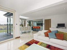 Stunning contemporary open plan living space with a cinema/games room - perfect for family and friends .