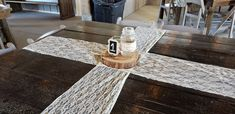 Rustic farm table with lace runners, mason jar and table number