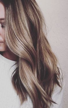 Color. Long hair with waves.