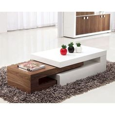 The lexy high gloss white and walnut coffee table is a modern extending coffee table. The lexy high gloss white and walnut coffee table can be reduced in size to limit the space required. Wooden Coffee Table Designs, Walnut Coffee Table, Coffee Table With Storage, Coffe Table, Table Storage, Wood Storage, Contemporary Coffee Table, Modern Coffee Tables, Modern Table