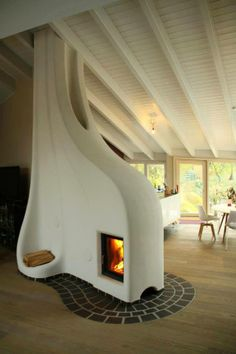Sculptural Adobe Stove by Lehm und Feuer