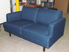 Bliss love seat in dark blue Dallas fabric and wood legs. on scan basics  http://scanhome.com/basics/social-gallery/img-7950