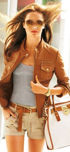 brown leather jacket, grey blouse and mini short