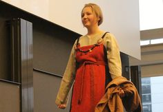 A complete female outfit in one of the Viking's most stylish colours, red. Shell-shaped brooches hold the dress in place. These went out of fashion midway through the Viking Age. (Photos by Johan Skov Andersen)