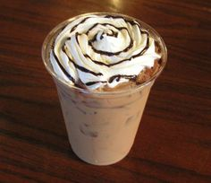 Iced Mocha - Made with fresh roasted espresso, natural Monin Dark Chocolate syrup topped with real (no-cans) whipped cream and Ghirardelli creamy chocolate sauce !