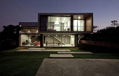 W House has a distinct color palette mainly defined by uncoated concrete gray, black-gray and brown-red