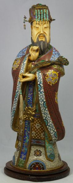 Exquisite Chinese cloisonne bronze and enamel figure with ivory. Depicts the first Emperor of China, Qin Shi Huang or Ying Zheng holding a Ruyi scepter. Exquisitely decorated throughout. Set with amber, malachite and turquoise beads. 18th/19th century.