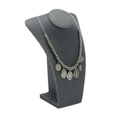 This petite bust is the perfect way to show off a single necklace or pendant; the small profile of the display makes the most of limited showcase space, while still displaying any length of necklace. Wire tabs on the back of the form secure excess chain, allowing you to display your necklace at any length you like and still keep the display neat and elegant. The gray linen offers a sophisticated dark color with a subtle natural texture that helps keep the jewelry from sliding out of place. Bold Jewelry, Emerald Jewelry, Silver Jewelry, Diy Jewelry, Silver Ring, Fabric Display, Rio Grande Jewelry, Cafe Design, Jewelry Making Supplies