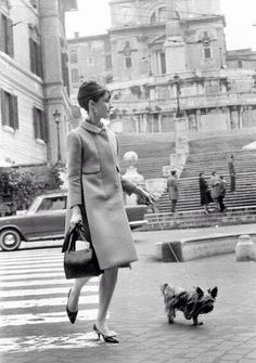 Ms. Hepburn in a beautiful coat with kitten heels