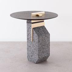 Small Pillar table by Formafantasma made from basalt rock