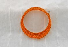 Orange rocaille memory wire bangle