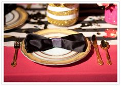 black bow tie napkin fold for 1950s wedding reception | classy touch by folding sleek black napkins to look like bow ties ...