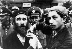 Nazi Germany 1933 persecution of the Jews. Jewish boy cuts his fathers beard while German soldiers watch jeeringly. Jewish History, World History, World War Ii, Ww2 History, Boy Cuts, Historical Photos, Wwii, The Past, Germany