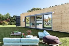 A bright, modern shipping container home from Greek builder, Cocoon Module. A beautiful eco-friendly space with a live roof!