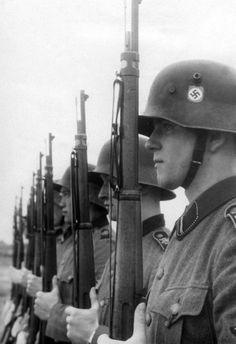 Troops of the Leibstandarte. It originated as a spit-and-polish unit for the protection of Adolf Hitler. It evolved into a savage Waffen-SS outfit. This picture must have been taken late in the war, note the presence of an apparently Asian soldier.