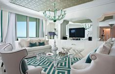 Interior : Hollywood Regency Interiors Styles Turquoise White Shades Geometric Rug Square Glass Top Coffee Table Two Ottoman White Sofa And Two Armchairs Modern Chandelier Wall Tv Stand Cushions 2 Basic Interior Paint Ideas To Remember Home Interior Idea. Interior Paint Ideas. Interior Paint Colors.
