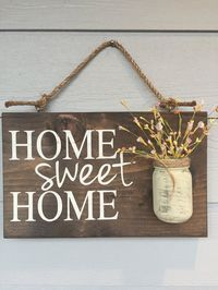 "Rustic Outdoor Home Sweet Home Sign  Great for hanging outside your home or indoors.  Makes a great housewarming gift for any home.  - Size is approximately 12 X 18 inches.  Depth is approximately 5"" with the Mason jar. - Comes ready to hang - Light seale"