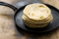 Hatch chile flour tortillas!  Yum. Now that my local Whole Foods Market is selling roasted Hatch chiles, I must grab some and make these. The Homesick Texan's flour tortilla recipe is a staple in our house...the addition of roasted hatch chiles?!? Makes it even more fabulous :)