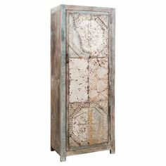 """Showcasing an embossed metal door and a reclaimed wood frame, this rustic cabinet stows linens in your guest room or china in the dining room with equal aplomb.   Product: CabinetConstruction Material: Reclaimed wood and metalColor: WhiteFeatures: One doorEmbossed metalDimensions: 80"""" H x 31"""" W x 18"""" D Cleaning and Care: Wipe clean with dry cloth. Do not clean with harsh chemicals."""