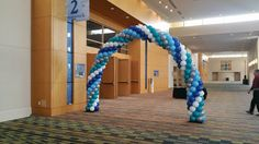 a five color spiral balloon arch apx 25 feet total length. apx 12 wide x 12 high