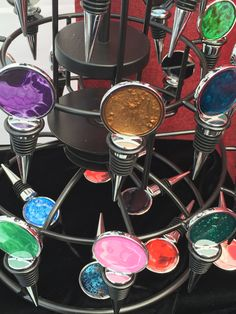 Wine stoppers in resolving display. Wine Stoppers, Resin Art, Art Pieces, Alcohol, Organic, Display, Rubbing Alcohol, Floor Space, Billboard